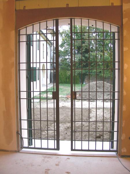 Porte e Portoni a scomparsa in ferro battuto ed acciaio inox - R2 ...