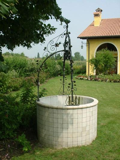 Lavorazione ferro battuto acciaio e bronzo su disegno - Pozzi da giardino ...